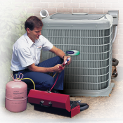 A repairman crouching beside an air conditioning unit