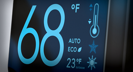 A thermostat reading 68 degrees farenheit