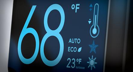 A thermostat reading 68 degrees farenheit