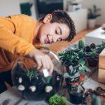 Boy with terrarium at home